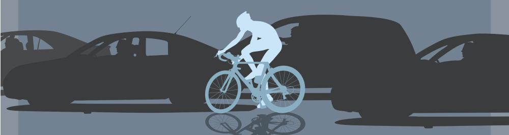 Biker rides with traffic